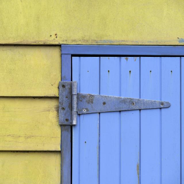"""Blue door on yellow wall"" stock image"
