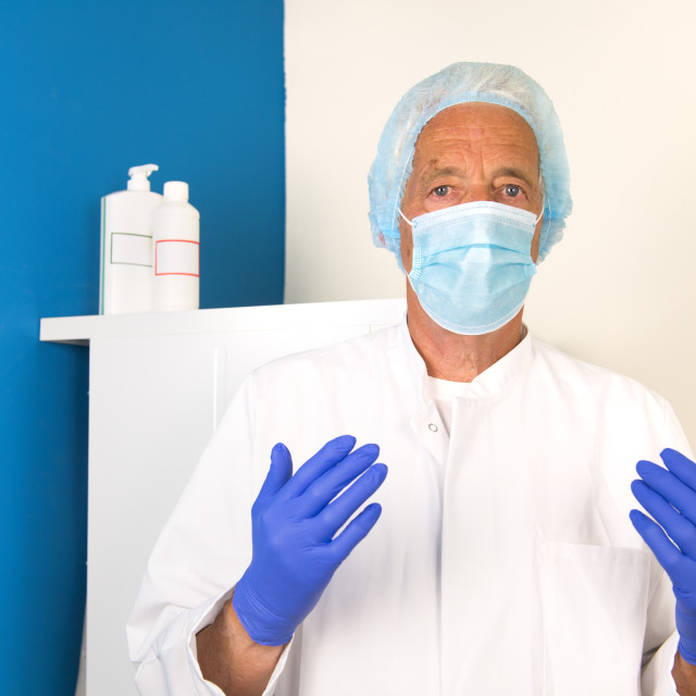 """""""Doctor with face mask and gloves"""" stock image"""