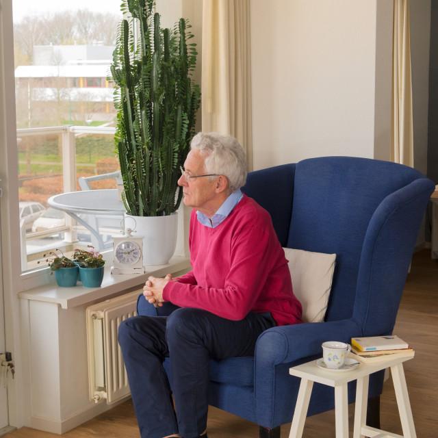 """Senior man alone in interior"" stock image"