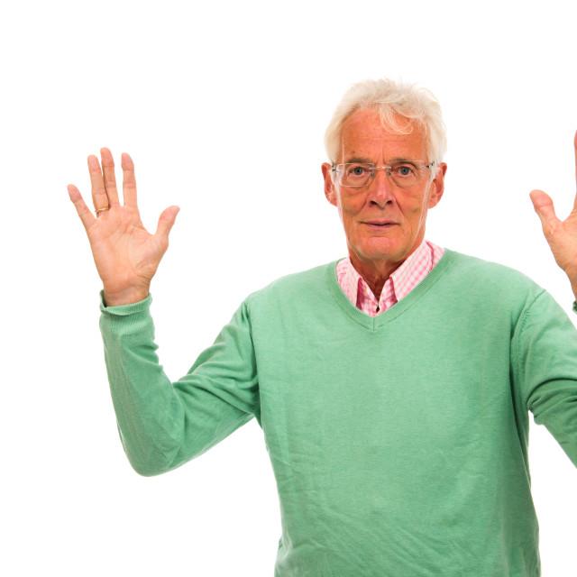"""Senior man in green jumper"" stock image"