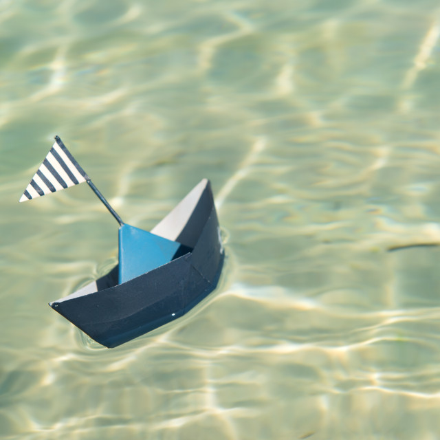 """""""Paper boat floating on water"""" stock image"""