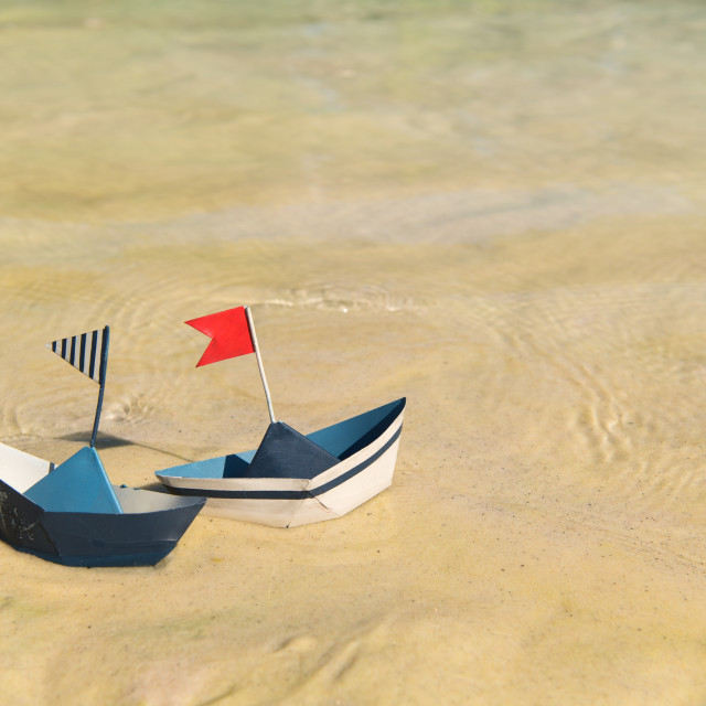 """""""Paper boats floating on water"""" stock image"""