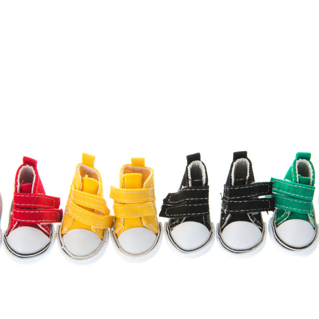 """""""Row colorful little sneakers"""" stock image"""