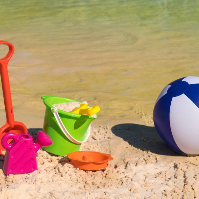 """""""Plastic toys at the beach"""" stock image"""