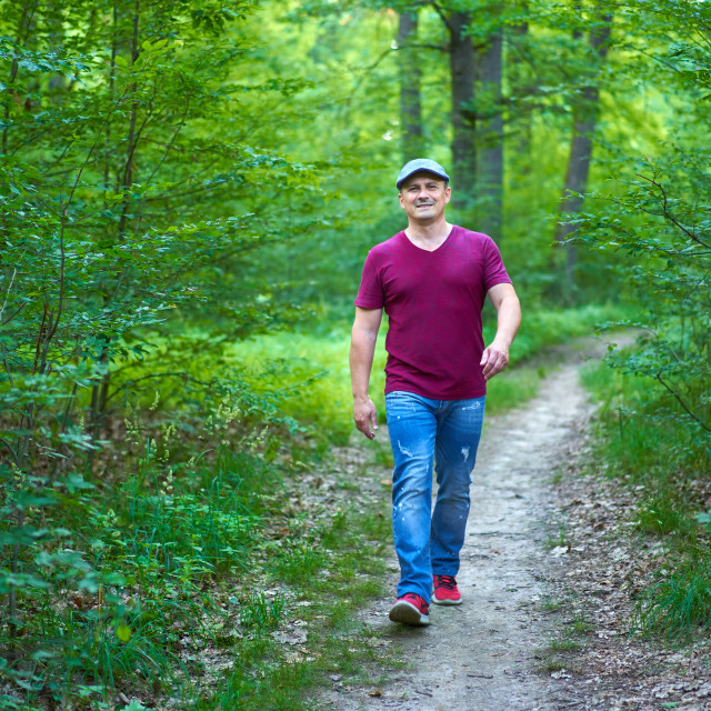 """""""Man walking in the forest"""" stock image"""