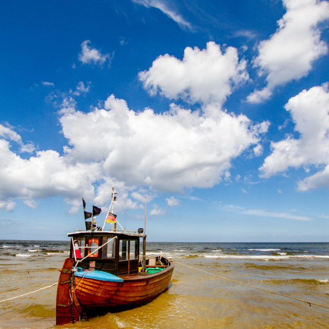 """""""Photographs of Ahlbeck a Seaside Resort on the Baltic Sea Coast, Germany. Small fishing boat anchored on the beach."""" stock image"""