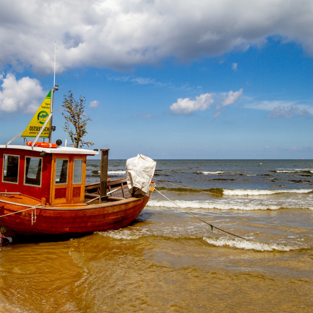 """Photographs of Ahlbeck a Seaside Resort on the Baltic Sea Coast, Germany. Small fishing boat anchored on the beach."" stock image"