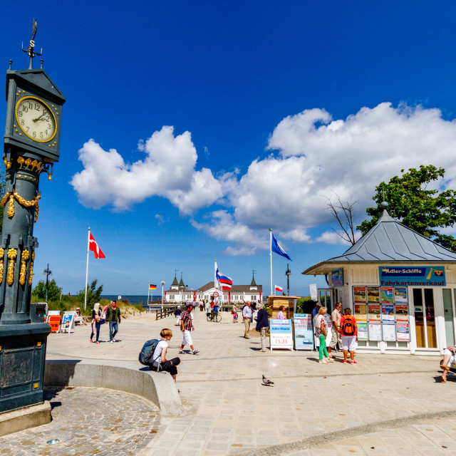 """Photographs of Ahlbeck a Seaside Resort on the Baltic Sea Coast, Germany. Ornate Clock to foreground and Preserved Pier to Background."" stock image"