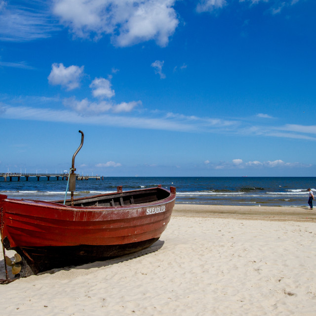"""""""Photographs of Ahlbeck a Seaside Resort on the Baltic Sea Coast, Germany. The Beach on a Sunny Day. Fishing Boat Seeadler to the Forground."""" stock image"""