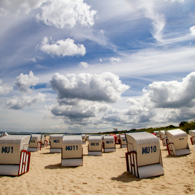 """Photographs of Ahlbeck a Seaside Resort on the Baltic Sea Coast, Germany. The Beach on a Sunny Day. Wicker Sun Shades to Foreground."" stock image"