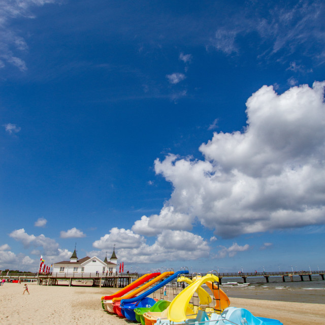 """Photographs of Ahlbeck a Seaside Resort on the Baltic Sea Coast, Germany. The Beach on a Sunny Day. Pedal Boats with Water Slides to Foreground and Pavilion in Background."" stock image"