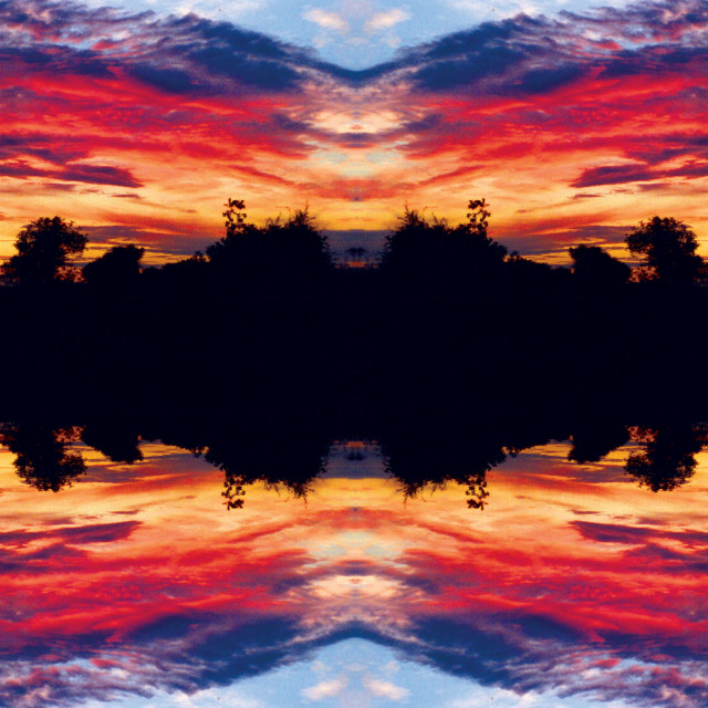 """""""Sunset Joined Mirrored"""" stock image"""