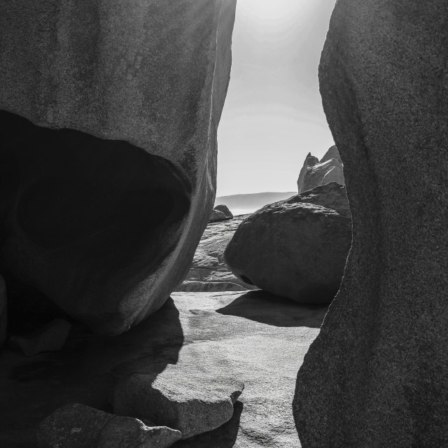 """A beam of light shining between the rocks"" stock image"