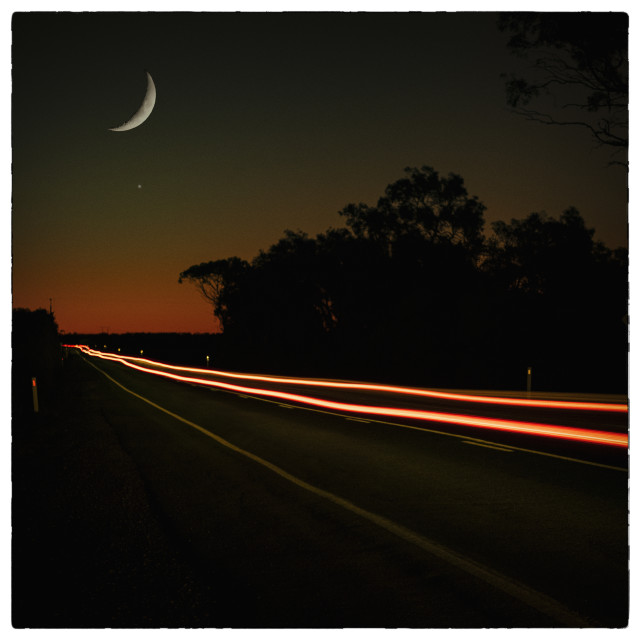 """""""Car Lights, Moon and Sunset"""" stock image"""