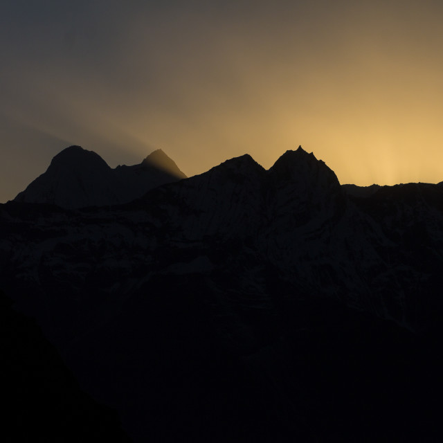 """Kongde and other peaks of Rolwaling backlit by the setting sun"" stock image"