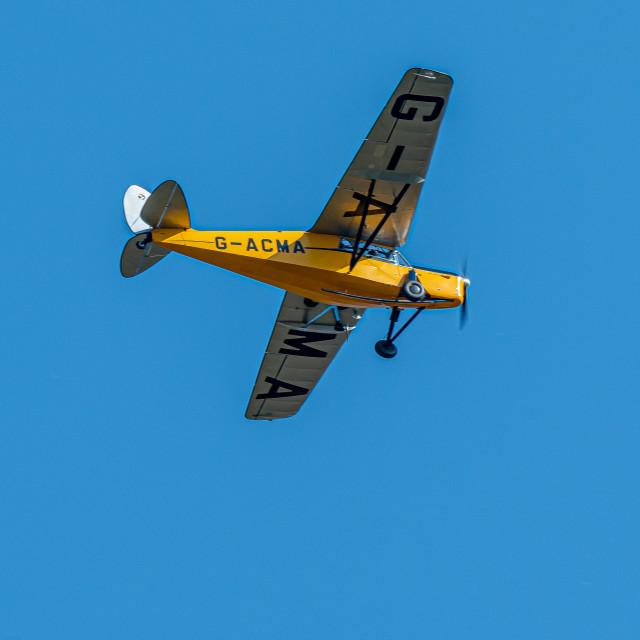 """Yellow Plane Flypast"" stock image"