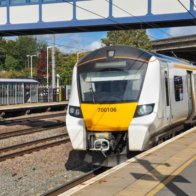 """Class 700 EMU calls at Huntingdon"" stock image"