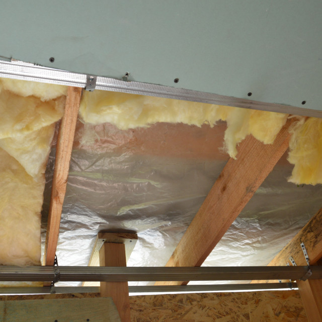 """""""Plasterboard ceiling lining and its insulation"""" stock image"""