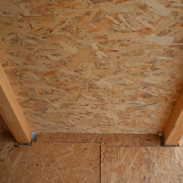"""""""Cladding wood chipboards at home"""" stock image"""