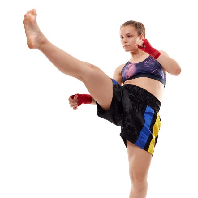 """Kickboxing girl doing front kick"" stock image"