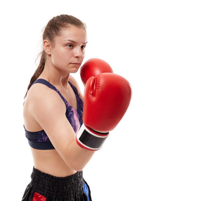 """Kickboxing girl on white"" stock image"
