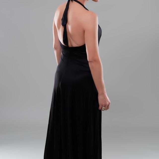 """Woman in black dress"" stock image"