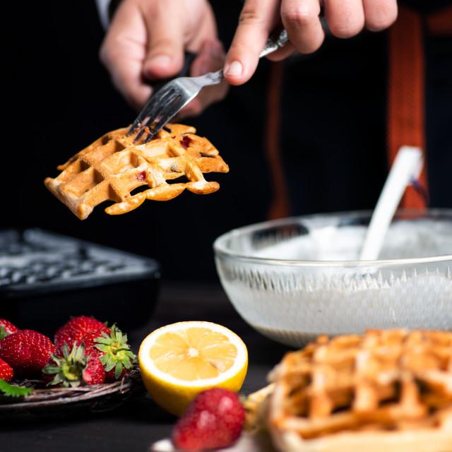 """""""Man making waffles on a waffle machine"""" stock image"""
