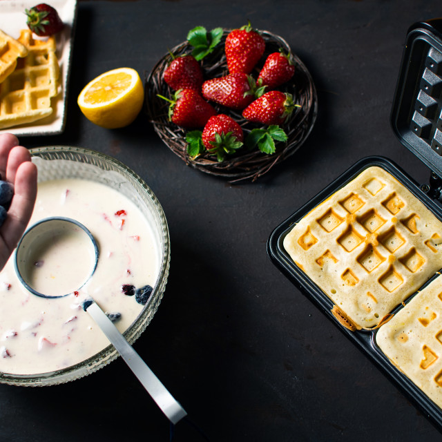 """""""Chef adding fruit in waffles dough"""" stock image"""