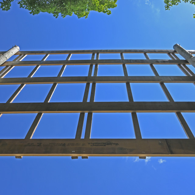 """""""A Wooden Structure against the clear Blue Sky."""" stock image"""