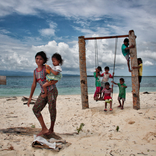 """Children Play on Pulau Koloray, Morotai"" stock image"