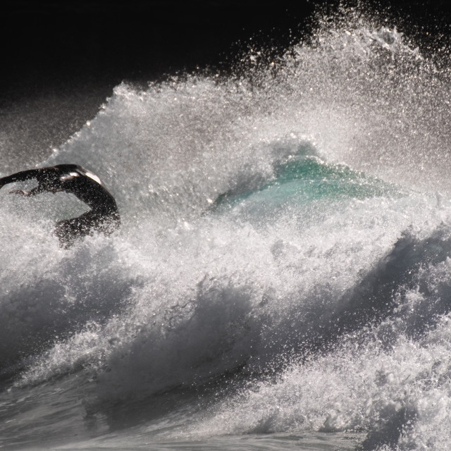 """""""Riding the breaking wave"""" stock image"""