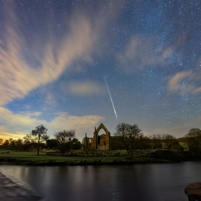 """""""Geminid meteor in Bolton Abbey"""" stock image"""