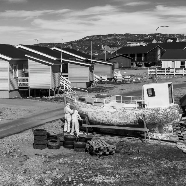 """Repairing the boat, Ilulissat"" stock image"