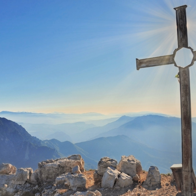 """""""sunrise back of a cross at the top of the mountain under sky"""" stock image"""