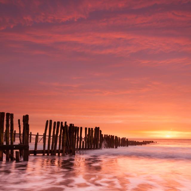 """""""Sunrise at Old Groyne Dawlish Warren"""" stock image"""