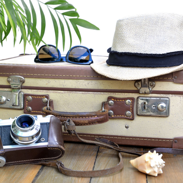 """""""retro suitcase and camera on on wooden table with straw hat and"""" stock image"""