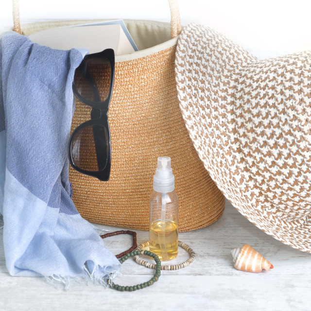"""""""straw bag and hat with female accessories to go to the beach on"""" stock image"""