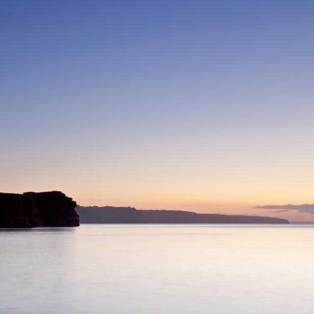 """Serene Dawn at Ladram Bay"" stock image"