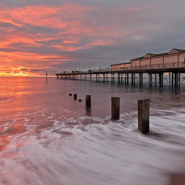 """Sunrise at Teignmouth Pier"" stock image"