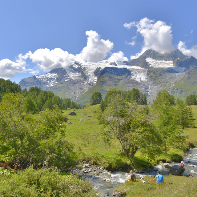 """beautiful landscape of european alps in summer with people seatting by the river"" stock image"