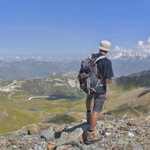 """hiker at top mountain looking alpine landscape"" stock image"