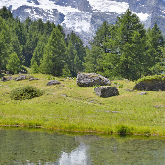 """scenery landscape in alpine mountain with a lake and reflection in water"" stock image"