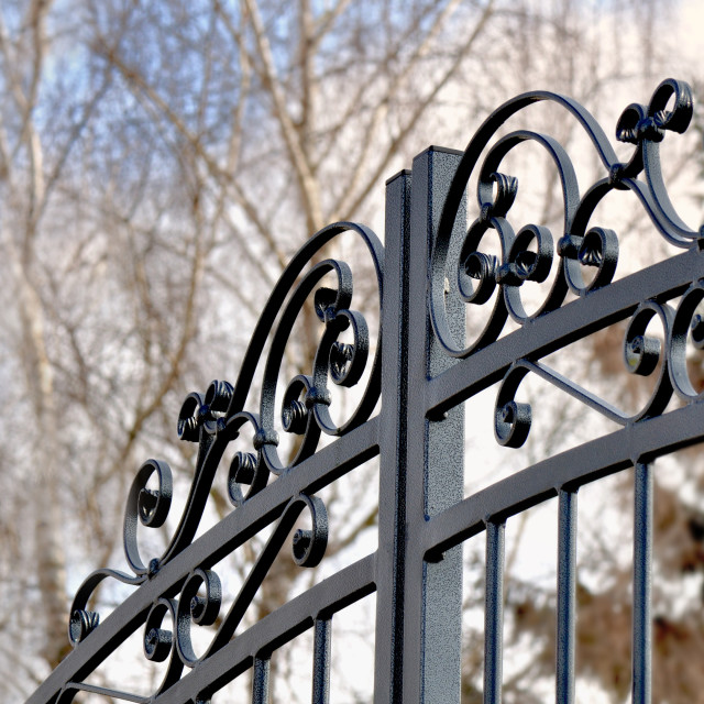 """close on a black metal fence closed a private garden"" stock image"