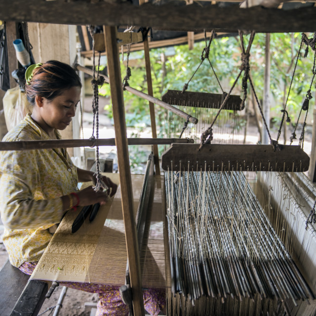 """""""A Cambodian woman weaves silk"""" stock image"""
