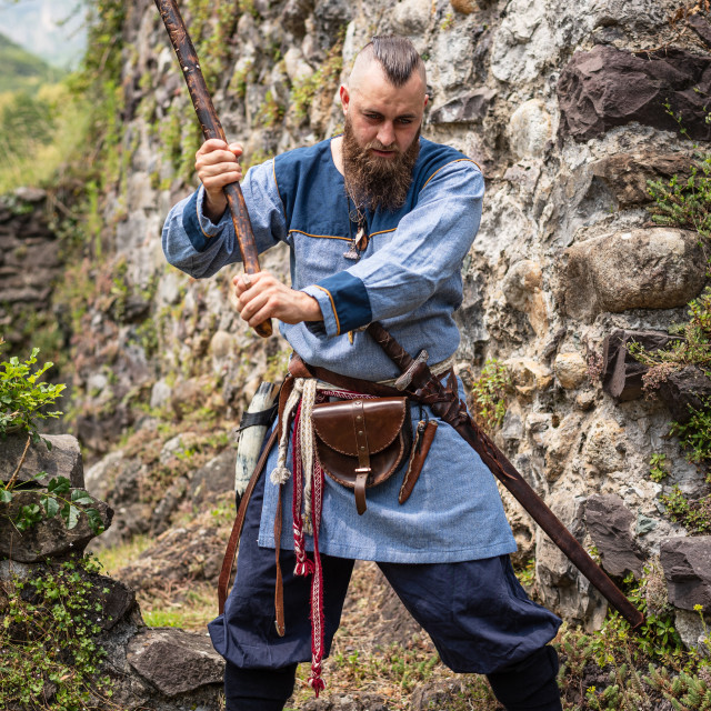 """""""Viking warrior brandishes an ax in a threatening way"""" stock image"""