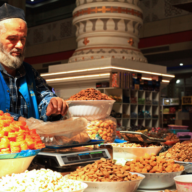 """Man selling dried fruits at the local market"" stock image"