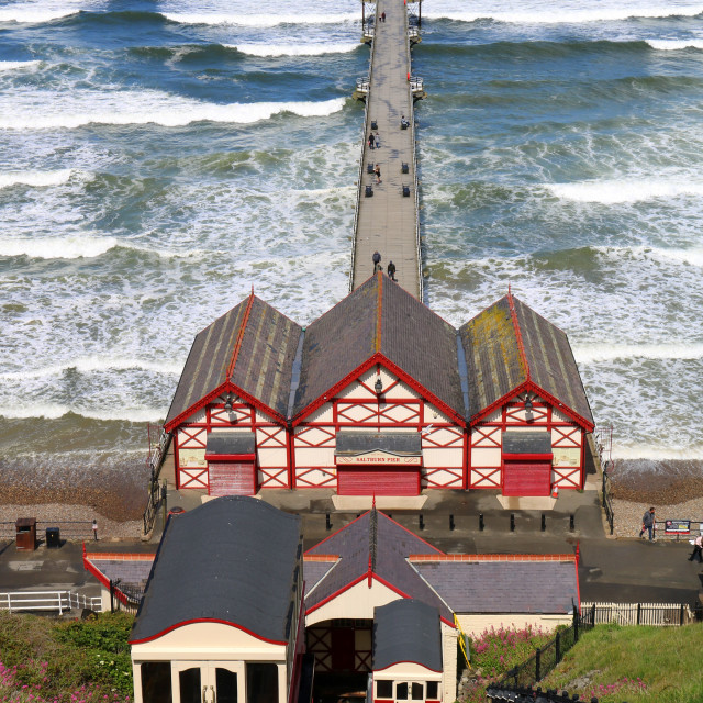 """Rough seas and Saltburn Pier. Cliff lift (funicular) parked up."" stock image"