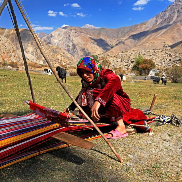 """""""Girl weaving wool in Fann mountains"""" stock image"""