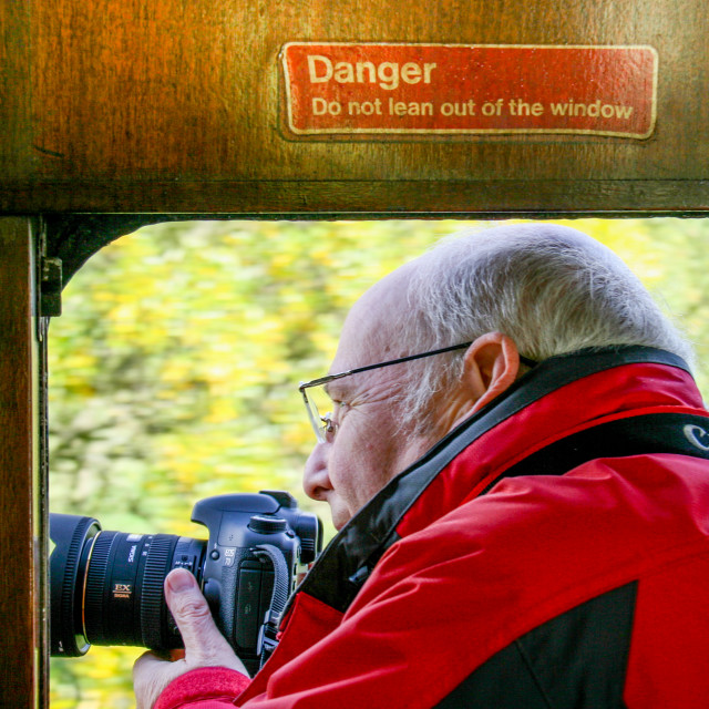 """""""Embsay and Bolton Abbey Steam Railway, Photographer Breaking the Rules."""" stock image"""
