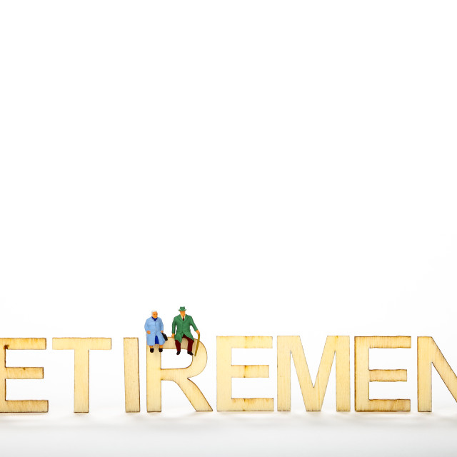 """Wooden retirement sign with elderly miniature figure people and copy space"" stock image"